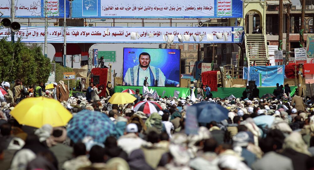 Yemeni Shiite supporters of the Huthi movement watch the movement leader Abdul-Malik al-Houthi deliver a televised speech during Eid al-Ghadir celebrations in the capital Sanaa. fILE PHOTO
