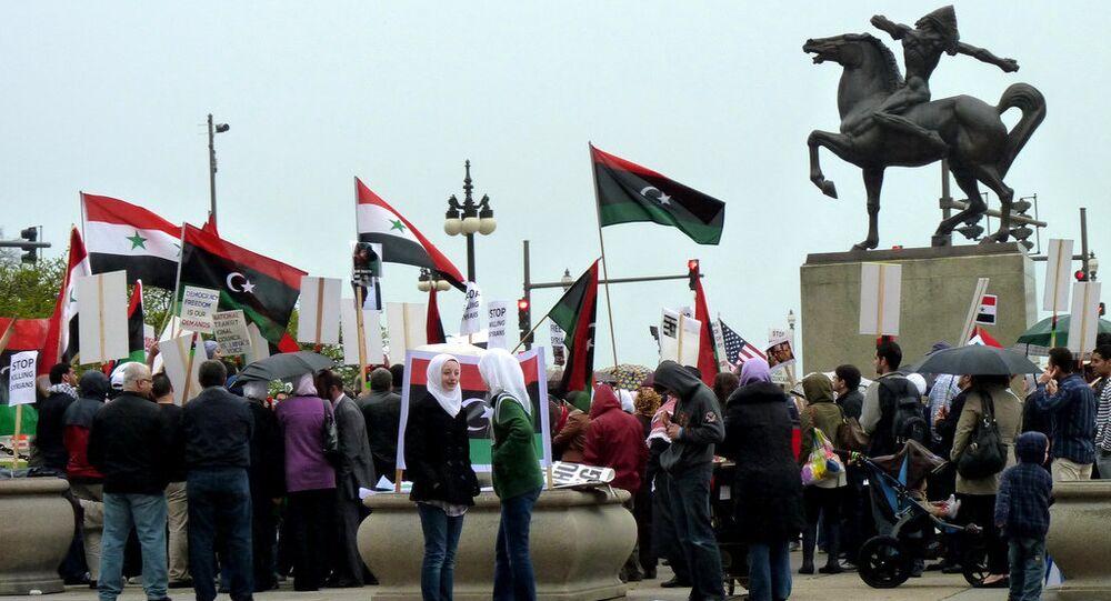 Syrian and Libyan pro-democracy demonstrators