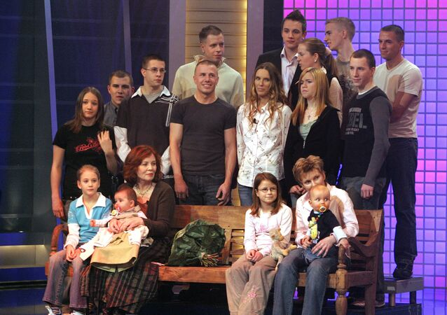 This photo taken on December 11, 2005 shows then 55-old Annegret Raunigk (1st row, 2ndL), posing with her youngest daugher Lelia (on her knees) and other children and grand-children in Cologne as guest in a German channel RTL show «2005! People, Photos, Emotions». File photo