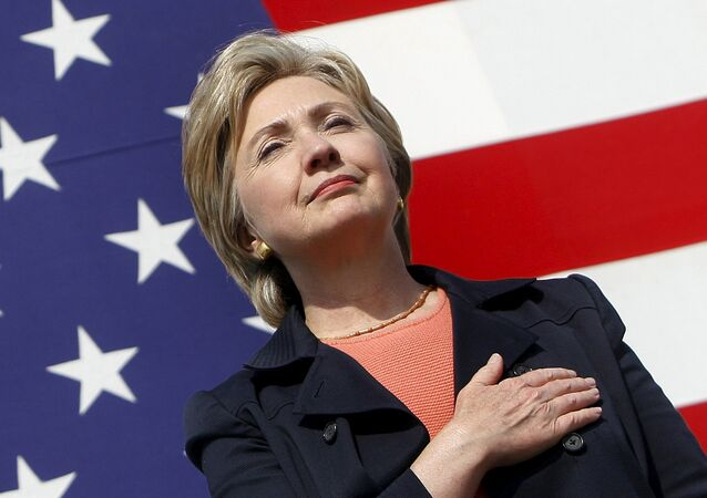 U.S. Senator Hillary Clinton (D-NY) places her hand over her heart during the National Anthem at the 30th annual Harkin Steak Fry in Indianola, Iowa, in this September 16, 2007 file photo