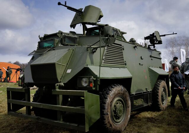 A Ukrainian weapons system installed on a British Saxon military armored personnel carrier during a presentation of new samples of Ukrainian-made weapons for the Ukrainian Army at a military base in Novi Petrivtsi outside Kiev, Ukraine, Saturday, April 4, 2015