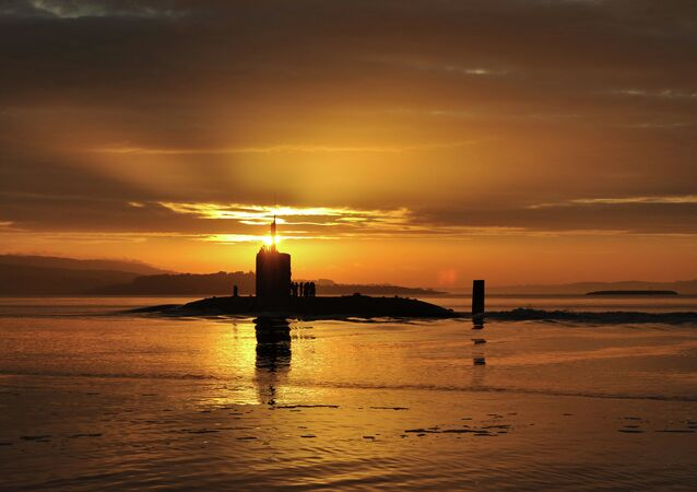 In this image made available by the Ministry of Defence in London, Monday Oct. 18, 2010, the sun rises over the Royal Navy nuclear attack submarine HMS Triumph, as she comes into a naval base on the River Clyde in Scotland, early Sunday Oct. 17, 2010