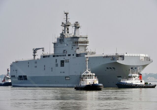 The Sevastopol mistral warship is on its way for its first sea trials, on March 16, 2015 off Saint-Nazaire
