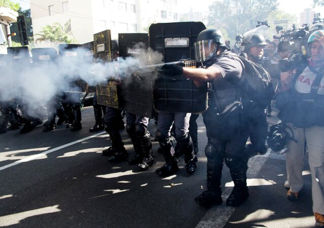 Police fire rubber bullets at protestors in Sao Paulo, Brazil, Thursday, June 12, 2014