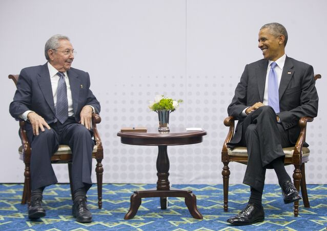 US President Barack Obama, right, smiles as he looks over towards Cuban President Raul Castro, left, during their meeting at the Summit of the Americas in Panama City