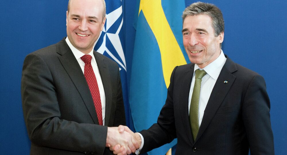 NATO Secretary General Anders Fogh Rasmussen (R) shakes hands with Swedish Prime Minister Fredrick Reinfeldt at the Rosenbad government office in Stockholm