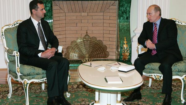 Syrian President Bashar Al-Assad and Russian President Vladimir Putin [left to right] meet each other in the Kremlin. - Sputnik International