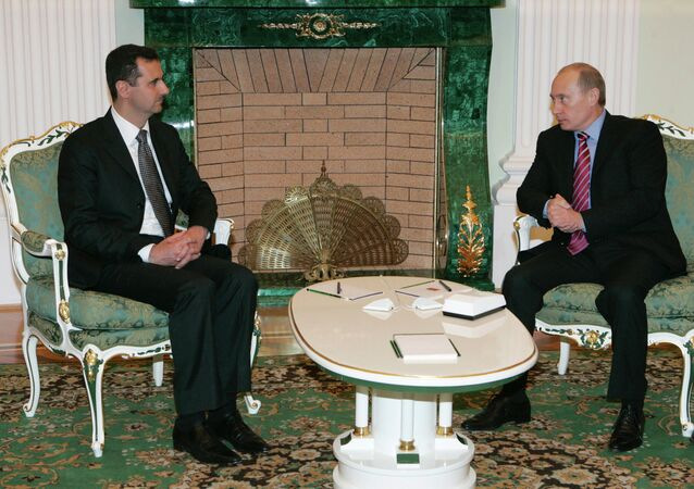 Syrian President Bashar Al-Assad and Russian President Vladimir Putin [left to right] meet each other in the Kremlin.