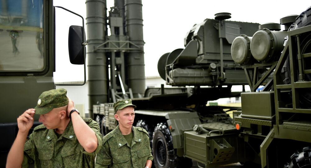 Russia's soldiers stand guard near Russia's air defence system S-400
