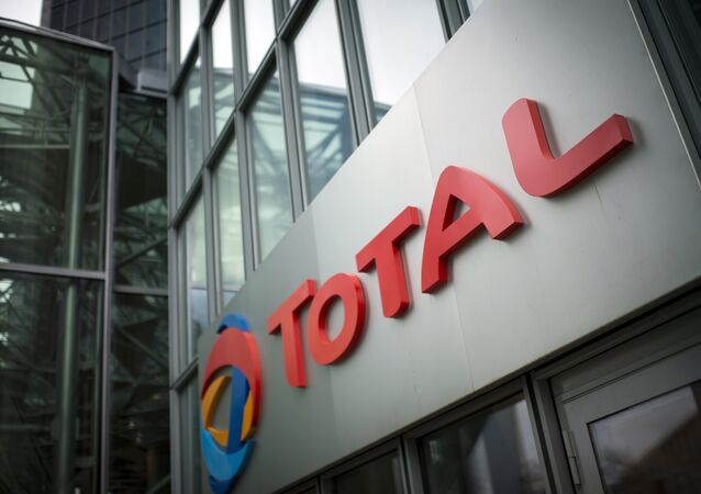 A picture shows the logo of French oil company headquarters Total, on October 21, 2014 in La Defense buisness district, near Paris
