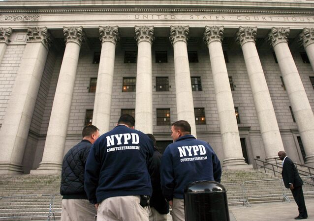 Members of the NYPD Counterterrorism unit talking outside the old federal courthouse in Manhattan.