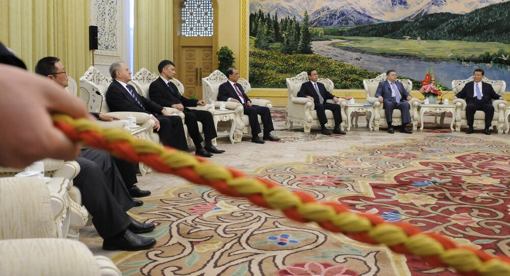 China's Vice President Xi Jinping (far R) holds talks with delegates of The Seventh Meeting of the SCO Security Council Secretaries at the Great Hall of the People in Beijing on April 12, 2012