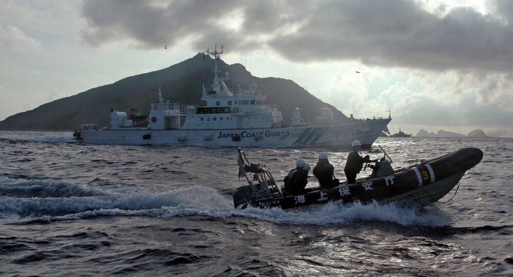 Japanese Coast Guard boat and vessel sail alongside Japanese activists' fishing boat, not in photo, warning the activists away from a group of disputed islands called Diaoyu by China and Senkaku by Japan