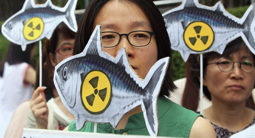 Environmentalists stage a rally denouncing imported agricultural and marine products from Japan without radioactivity test in front of the Japanese Embassy in Seoul, South Korea, Thursday, Aug. 1, 2013
