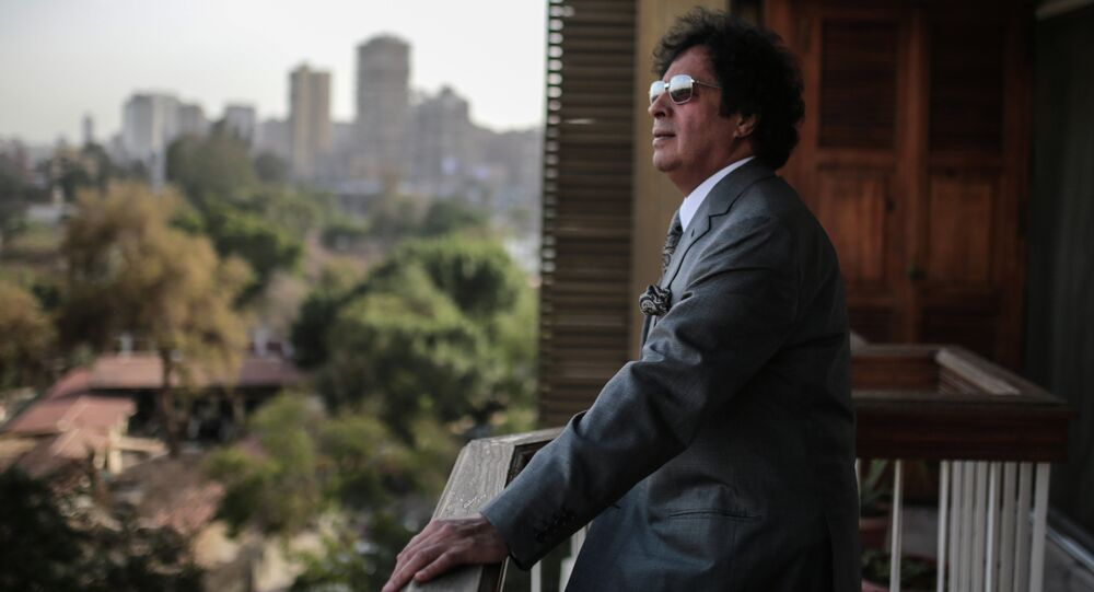 Ahmed Qaddaf al-Dam, cousin of Libya's former president Muammar Gaddafi, poses for a photo at his apartment, in Cairo, Egypt, Wednesday, Feb. 25, 2015
