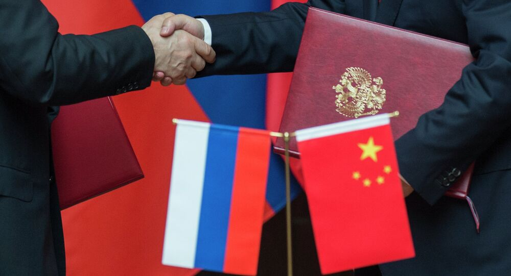 Russian and Chinese companies plan to sign dozens of deals worth over $10 billion during President Xi Jinping's visit to Moscow