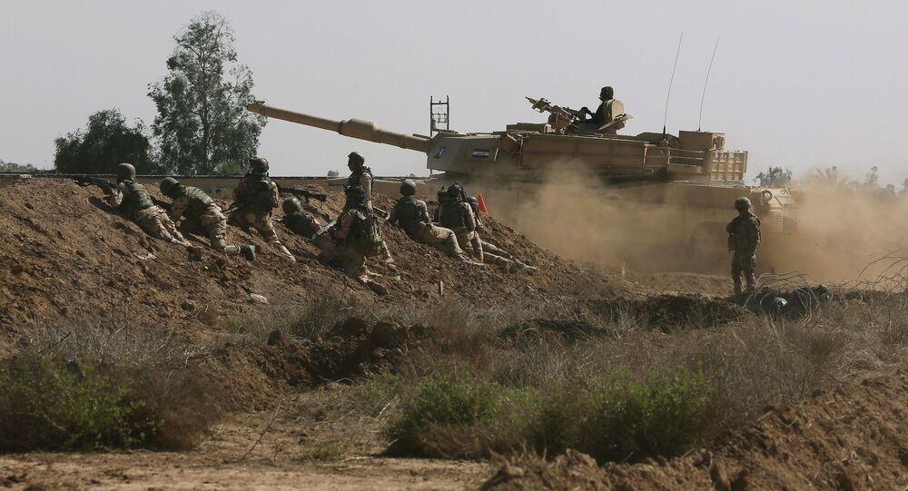 Iraqi security forces participate in a drill as U.S. forces help train them in Taji, north of Baghdad, Iraq.