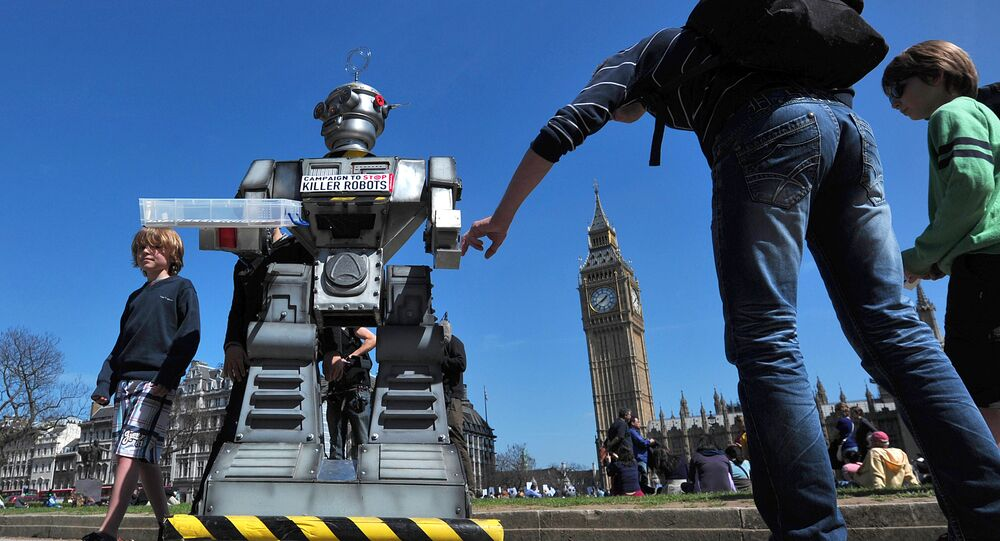 People look a mock killer robot in central London