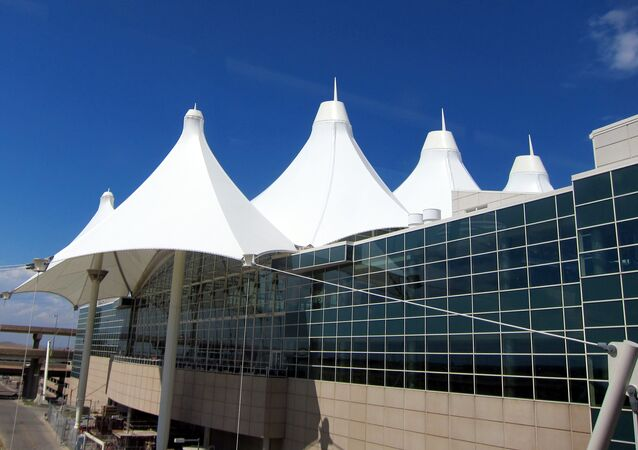 Denver International Airport's main terminal evacuated by authorities to investigate a possible security threat.
