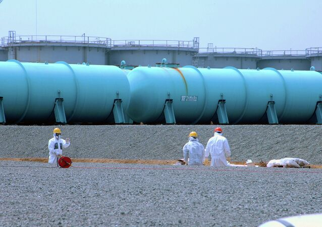 Workers at TEPCO's Fukushima Daiichi Nuclear Power Station work among underground water storage pools on 17 April 2013.