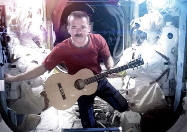 "Astronaut Chris Hadfield performs his own rendition of David Bowie's ""Space Oddity"" aboard the International Space Station"