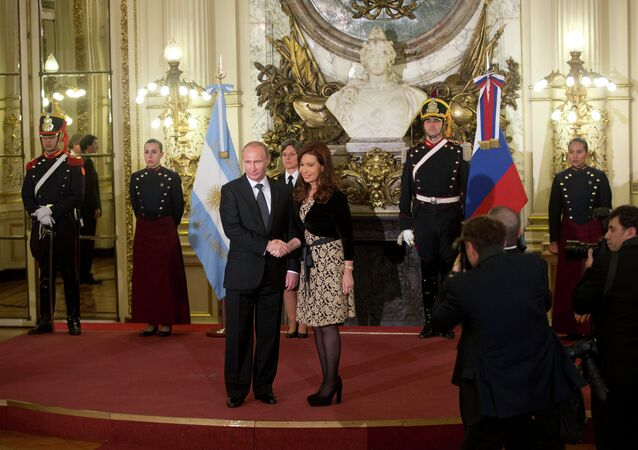 Russian President Vladimir Putin posing for a photograph with Argentina's President, Cristina Fernandez during his visit to Bueons Aires, July 12, 2014.