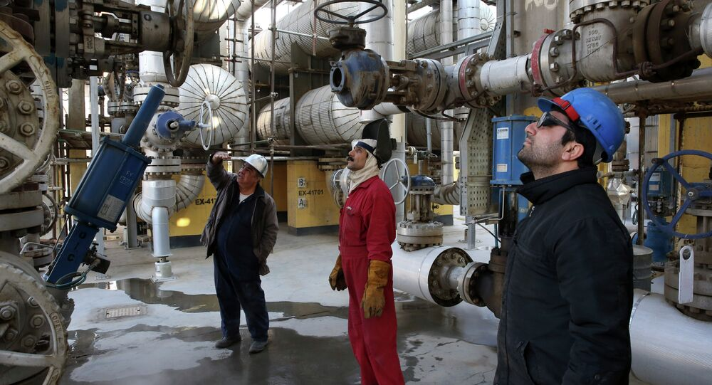 Iranian oil workers work at the Tehran's oil refinery south of the capital Tehran, Iran, Monday, Dec. 22, 2014