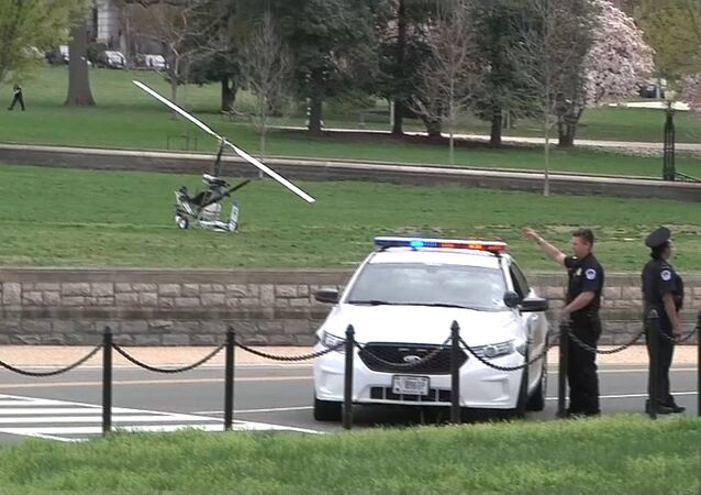 A gyrocopter (L) is pictured in this still image taken from video after it landed on the west lawn of the U.S. Capitol in Washington April 15, 2015