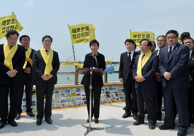 South Korean President Park Geun-hye (C) speaks during her visit to a port in Jindo on the occasion of the first anniversary of the ferry disaster that killed more than 300 passengers, April 16, 2015