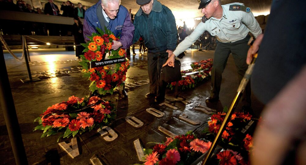 Holocaust survivors and their relatives lay a wreath next to the names of concentration camps during a ceremony marking the annual Holocaust Remembrance Day at the Hall of Remembrance at the Yad Vashem Holocaust memorial, in Jerusalem