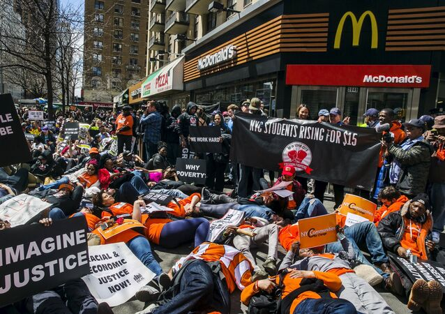 Protesters participate in a die in in front of a McDonald's restaurant during demonstrations asking for higher wages in the Manhattan borough of New York City April 15, 2015