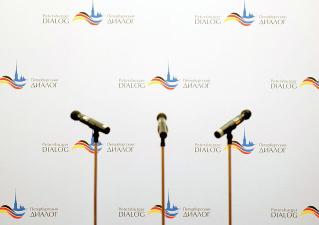 Microphones stand on the podium of the German-Russian forum Petersburg Dialogue