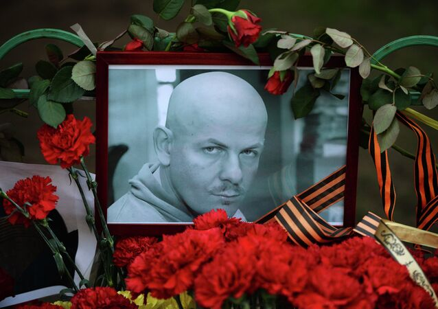 Flowers and candles laid at the Ukraine Embassy in Moscow in memory of journalist Oles Buzina killed in Kiev