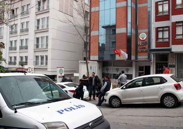 Police are seen outside the headquarters of the pro-Kurdish Peoples' Democratic Party, (HDP) early on April 18, 2015 in Ankara