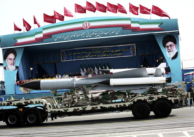 A S-200 surface-to-air missile system is driven past Iranian military commanders during the Army Day parade in Tehran on April 18, 2015.