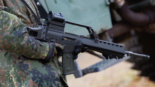 German soldier holds a Heckler & Koch G36 assault rifle at a military training ground near Weisskeissel,  Germany - Sputnik International
