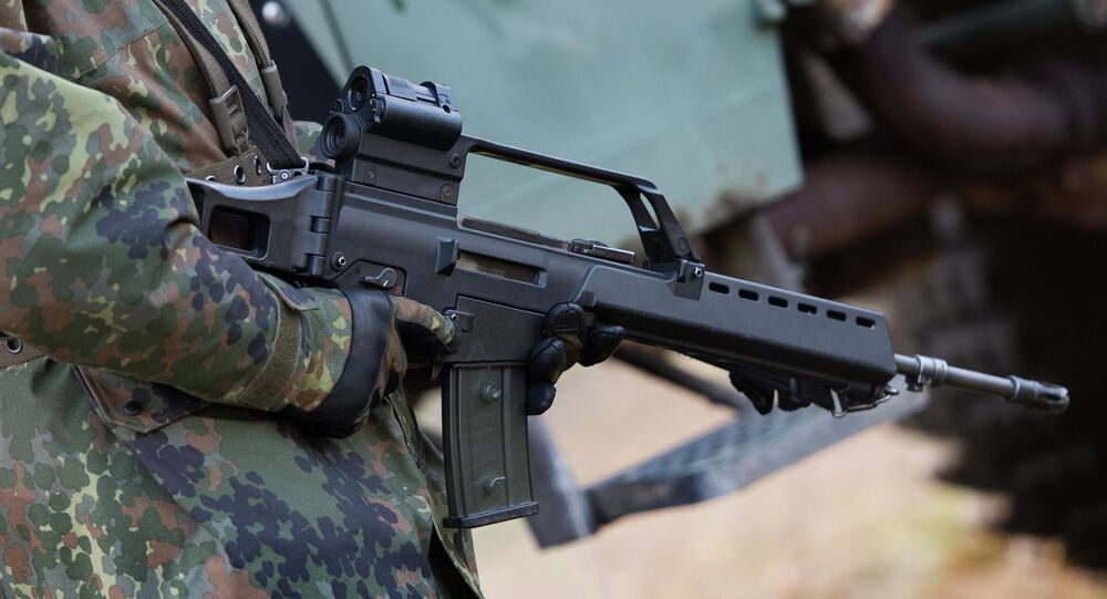 German soldier holds a Heckler & Koch G36 assault rifle at a military training ground near Weisskeissel,  Germany