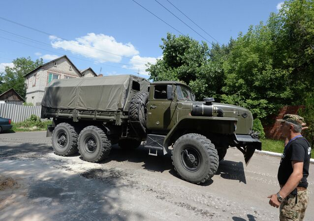 A military truck ran over the car of a local resident in Severodonetsk, Ukraine. The soldier driving the military vehicle was intoxicated.