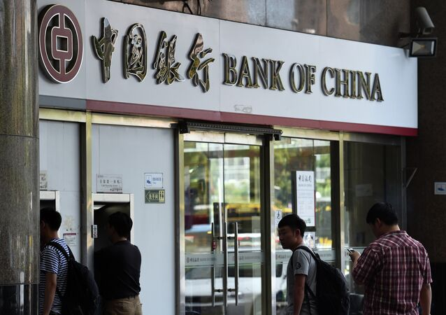 People wait outside a Bank of China branch in Beijing