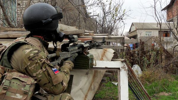 In this file photo dated Dec. 29, 2010, a Russian Special Forces officer aims his weapon during a security raid at a village outside Makhachkala, the regional capital of Russia's province of Dagestan - Sputnik International