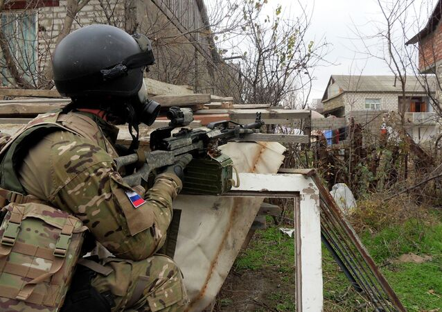In this file photo dated Dec. 29, 2010, a Russian Special Forces officer aims his weapon during a security raid at a village outside Makhachkala, the regional capital of Russia's province of Dagestan