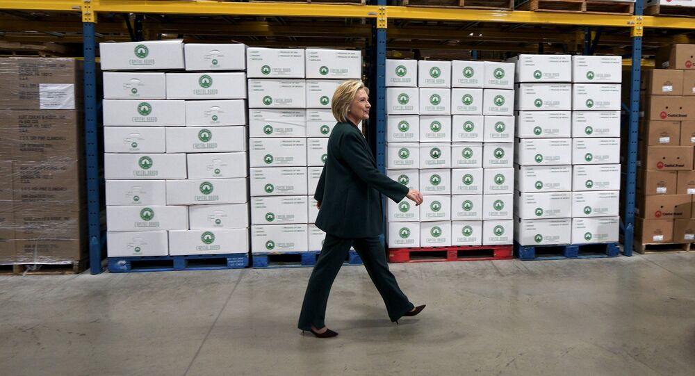 U.S. presidential candidate and former Secretary of State Hillary Clinton arrives to listen to small business owners as she campaigns for the 2016 Democratic presidential nomination at Capital City Fruit in Norfolk, Iowa April 15, 2015