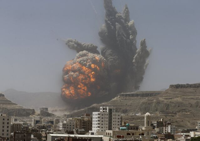 Smoke rises during an air strike on an army weapons depot on a mountain overlooking Yemen's capital Sanaa April 20, 2015