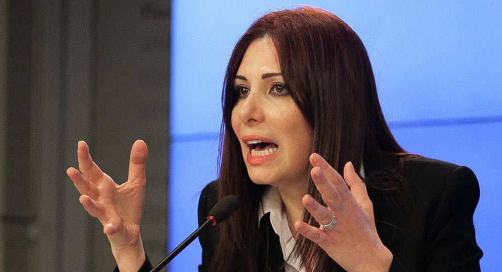 Member of the opposition delegation Randa Kassis speaks at a press conference in Moscow