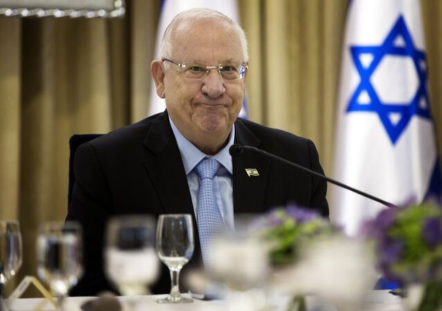 Israeli President Reuven Rivlin sits for consultations, with representatives of parties elected to parliament (Knesset) last week, at his residence in Jerusalem on March 22, 2015
