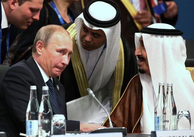 President of Russia Vladimir Putin and Crown Prince Salman bin Albdulaziz Al Saud talk through their interpreters during a plenary session at the G-20 summit in Brisbane, Australia, Saturday, Nov. 15, 2014