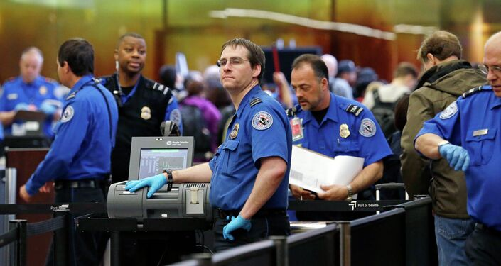 In this photo taken Tuesday, March 24, 2015, TSA agents work at a security check-point at Seattle-Tacoma International Airport in SeaTac, Wash.