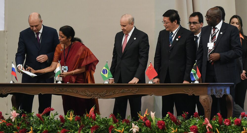 Delegates of the countries members of the BRICS (Brazil, Russia, India, China and South Africa) sign the creation of their new development bank during the 6th BRICS Summit in Fortaleza, Brazil, on July 15, 2014