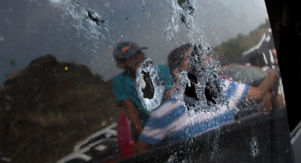 Bullet hole-riddled back windshield of a pickup truck involved in the shooting in Apatzingan, Michoacan state, Mexico.