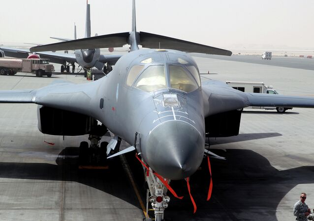 In this photo taken Monday, March 9, 2015, a B-1 bomber is seen at the al-Udeid Air Base in Doha, Qatar. The base is the regional nerve center for the air war against the militants who have taken over nearly a third of Iraq and Syria.